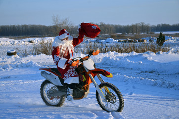 On a motorcycle motocross Santa Claus welcomes
