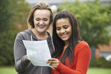 Two Female Students Celebrating Exam Results Together