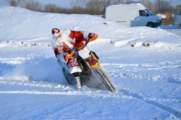 Santa Claus riding on a motorcycle turning MX