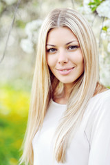 Beautiful young blonde woman face close up