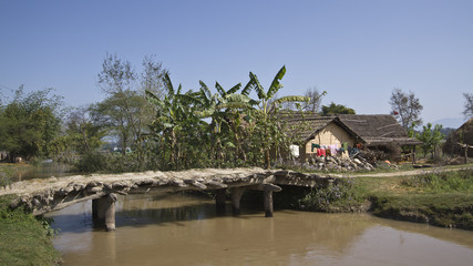 Wooden bridge in traditional village in Nepal