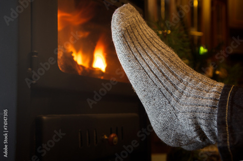 canvas print picture feet in stockings by the fireplace
