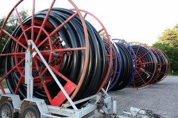Red cable drums with black cable