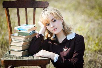 portrait of russian schoolgirl in the field