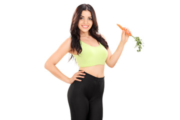 Female athlete eating a carrot