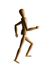 Wooden mannequin running upstairs