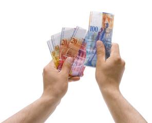 Schweizer Franken in der Hand