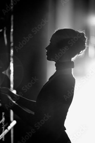 Leinwanddruck Bild Silhouette of a beautiful actress on the backstage, monochrome