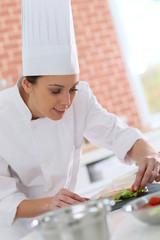 Smiling cook preparing appetizer