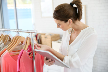 Shop woman preparing summer sales in store