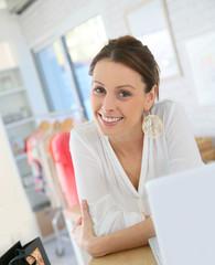 Beautiful shopgirl working in clothing store