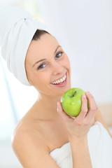 Beautiful woman holding green apple