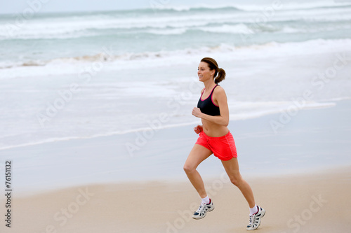 canvas print picture Woman running on the beach