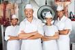 Leinwanddruck Bild - Male Butcher With Confident Team