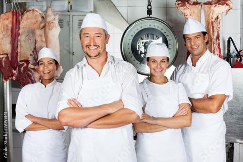 Leinwandbild Motiv Male Butcher With Confident Team