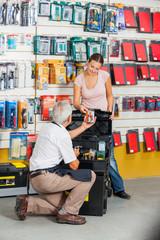 Salesman Assisting Customer In Hardware Store