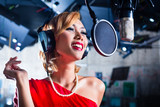 Asian singer producing song in recording studio poster