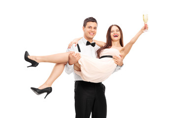Young couple drinking champagne and having fun