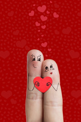 Finger art. Lovers is embracing and holding red heart.