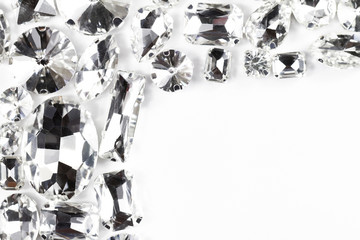 Large crystal strasses on a white background - macro photo
