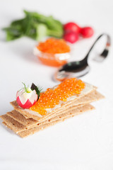 crispbread and red salmon caviar to supply the ideal figure