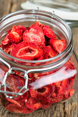 Dehydrated sliced strawberries in a glass jar