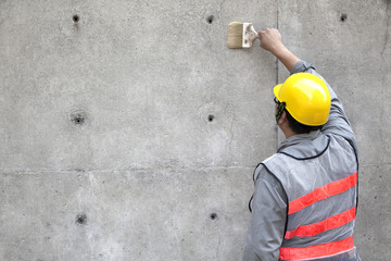 painter working on the old concrete wall