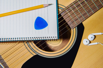 Guitar with pencil.