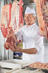 Butcher Giving Raw Meat At Counter