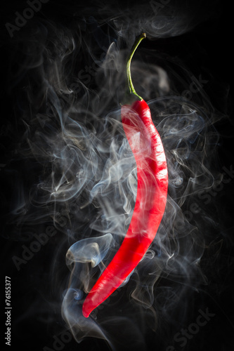 Smoking red hot chili Pepper on a  black background - 76155377