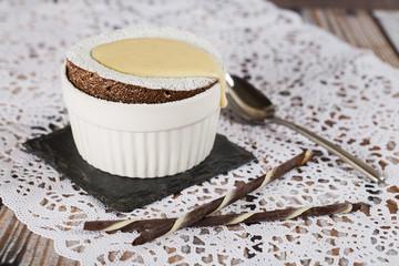 Chocolate souffle with vanilla liqueur sauce.