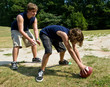 teenage brothers playing football