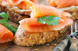 Smoked salmon canape with a fresh parsley leaf
