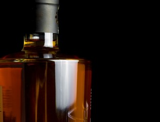 whiskey bottle on black background