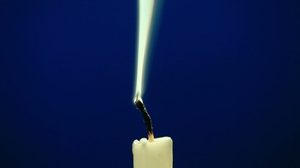 candle on a blue background