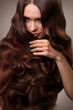 Hair. Portrait of Beautiful Woman with Long Wavy Hair. High qual