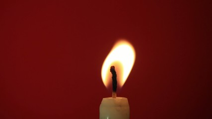 candle on a red background