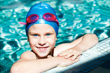 young swimmer training in the swimming pool