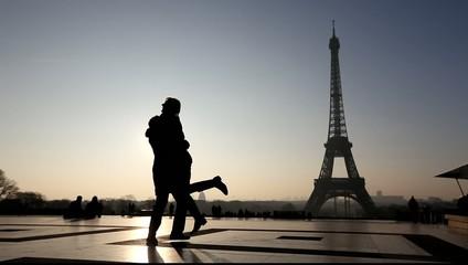 silhouettes of romantic couple near Eiffel Tower, Paris, France