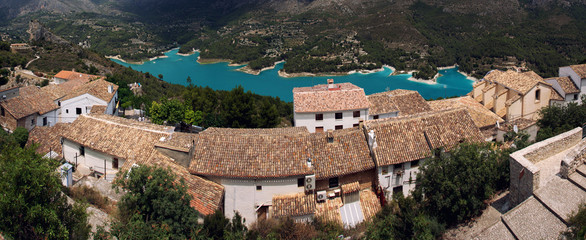 Guadalest Castle village with picturesque blue lake