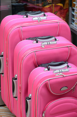 several pink suitcases