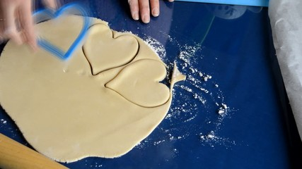 Woman Makes Heart Shapes Out Of Dough
