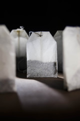 the tea bags on a dark background