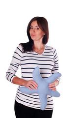 Pretty pregnant woman portrait with toy star