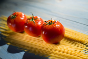 pasta and tomatoes on a blue background