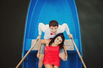 Loving young couple cuddling in rowboat