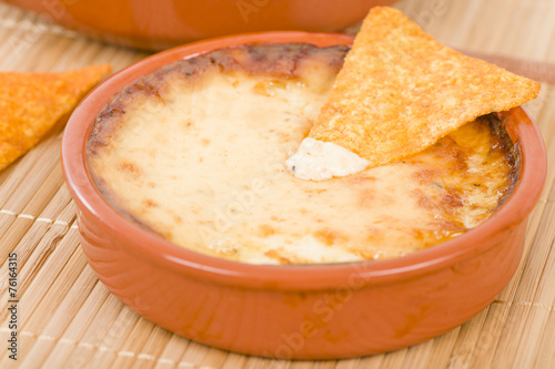 Baked Cheese - Melted cheese dip served with tortilla chips.