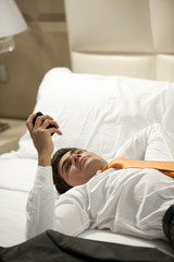 Tired Businessman Lying on Bed