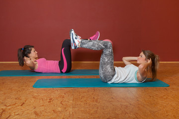 Fitness Training - 2 girls situp - warmup