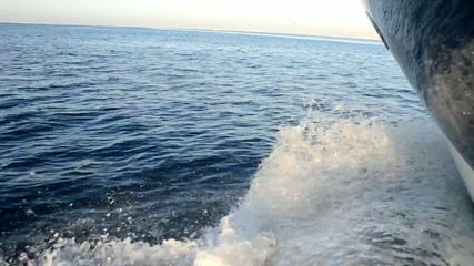 View of ocean from moving motor yacht